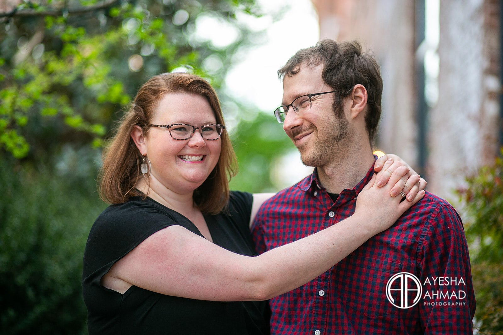 Jen and cameron embrace during couples session in Downtown Charlottesville Ayesha Ahmad Photography