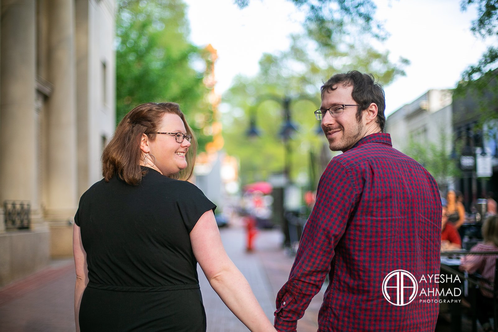 Jen and cameron hold hands during couples session in Downtown Charlottesville Ayesha Ahmad Photography