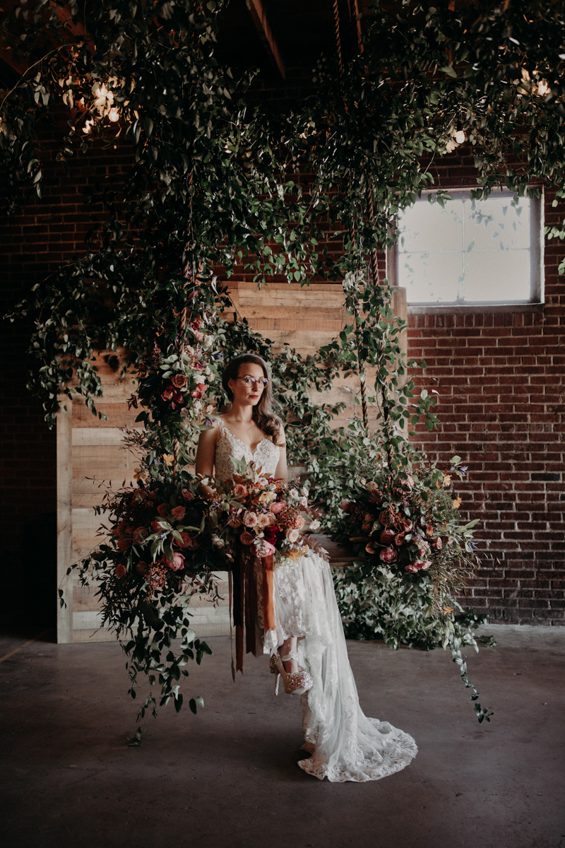 ABBY AND NICK WEDDING AMARILLO TX RITTER COLLECTIVE PHOTOGRAPHY NICK ON FLORAL SWING