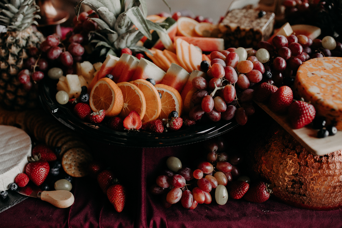 ABBY AND NICK WEDDING AMARILLO TX RITTER COLLECTIVE PHOTOGRAPHY TABLE WITH FRUIT AND CHEESE PLATES