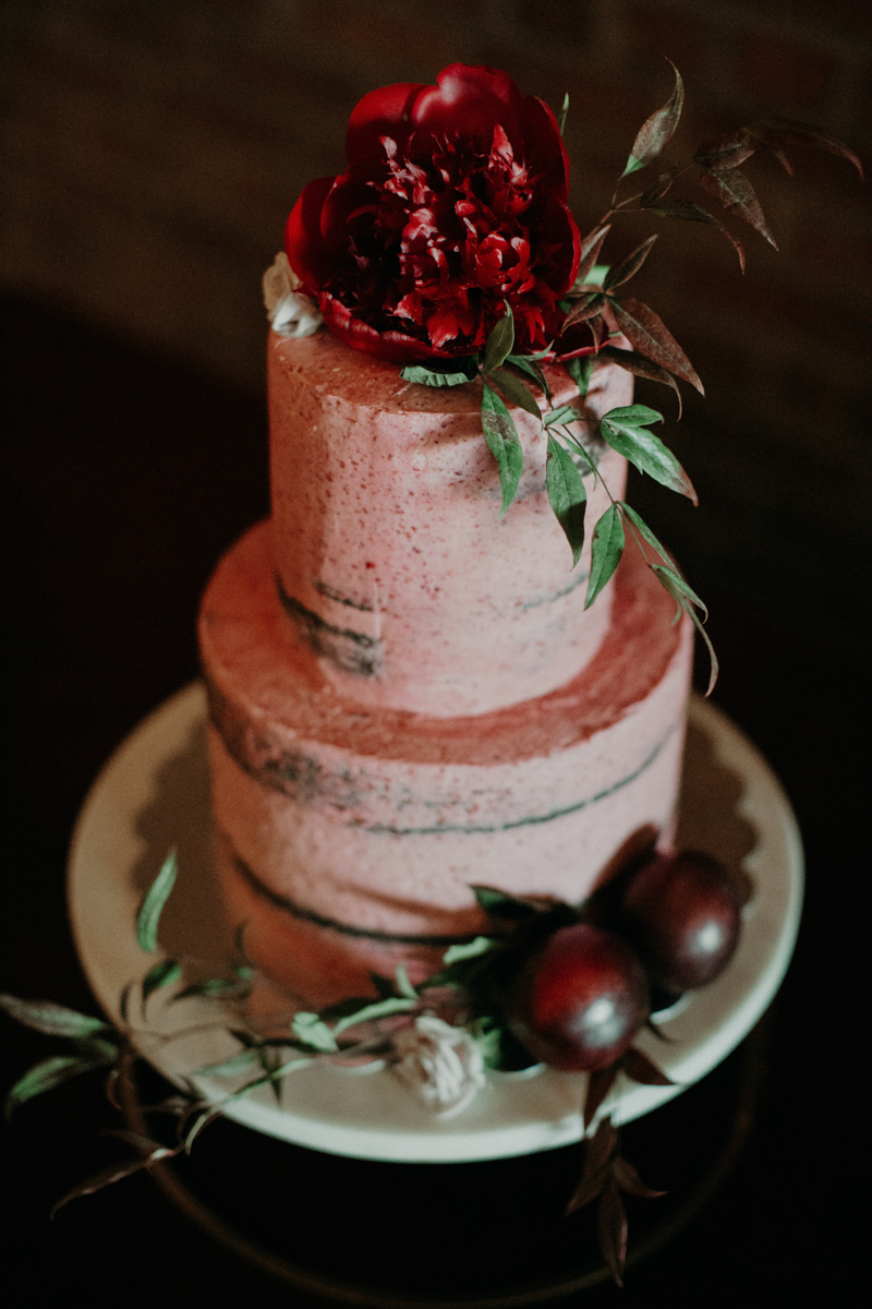 ABBY AND NICK WEDDING AMARILLO TX RITTER COLLECTIVE PHOTOGRAPHY CAKE WITH FLOWER TOPPER