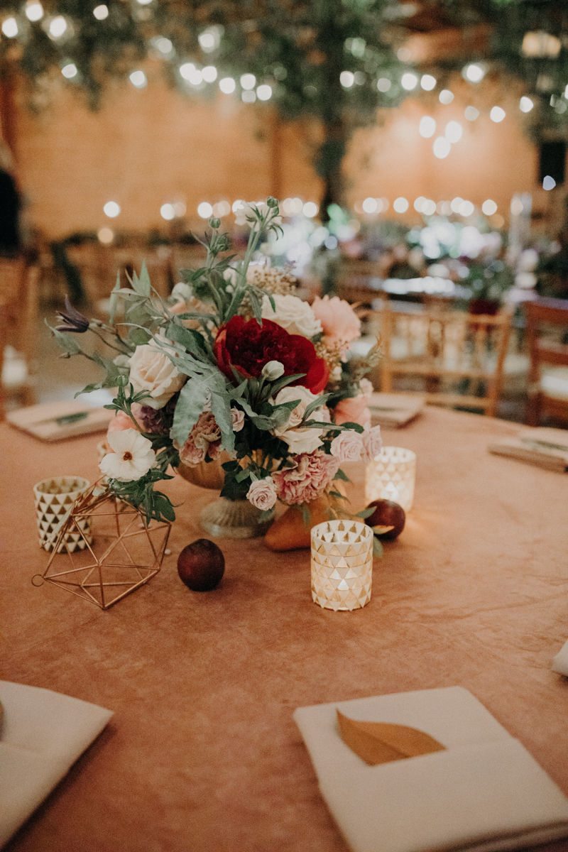 ABBY AND NICK WEDDING AMARILLO TX RITTER COLLECTIVE PHOTOGRAPHY TABLE WITH FLORAL, FRUIT, AND GEOMETRIC-SHAPE CENTERPIECES