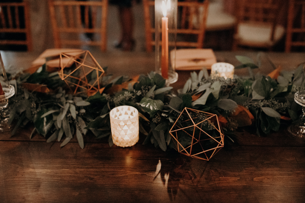 ABBY AND NICK WEDDING AMARILLO TX RITTER COLLECTIVE PHOTOGRAPHY BAR WITH GREENERY RUNNER, GEOMETRIC SHAPES, AND CANDLES
