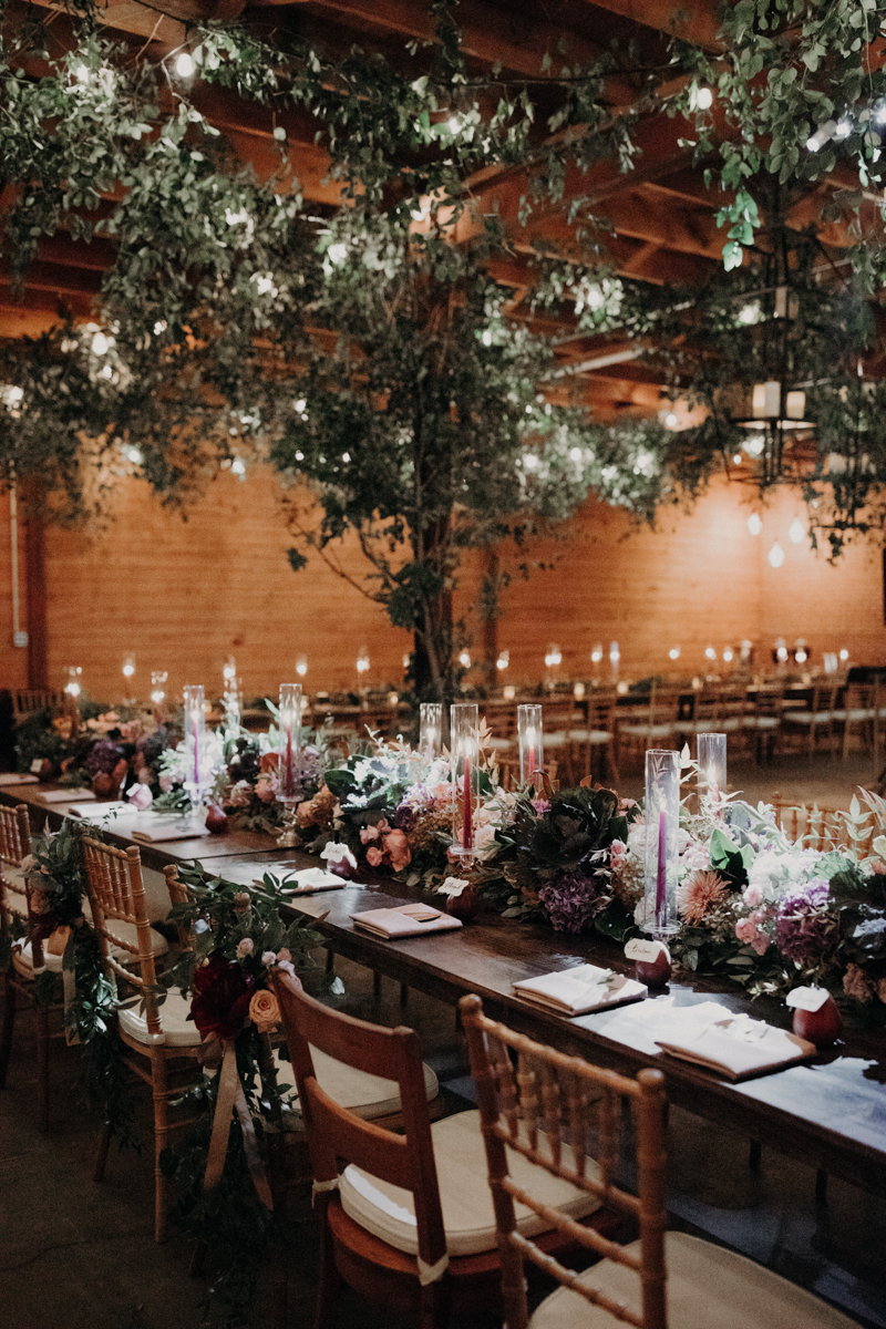ABBY AND NICK WEDDING AMARILLO TX RITTER COLLECTIVE PHOTOGRAPHY LONG TABLE WITH VINES IN RAFTERS