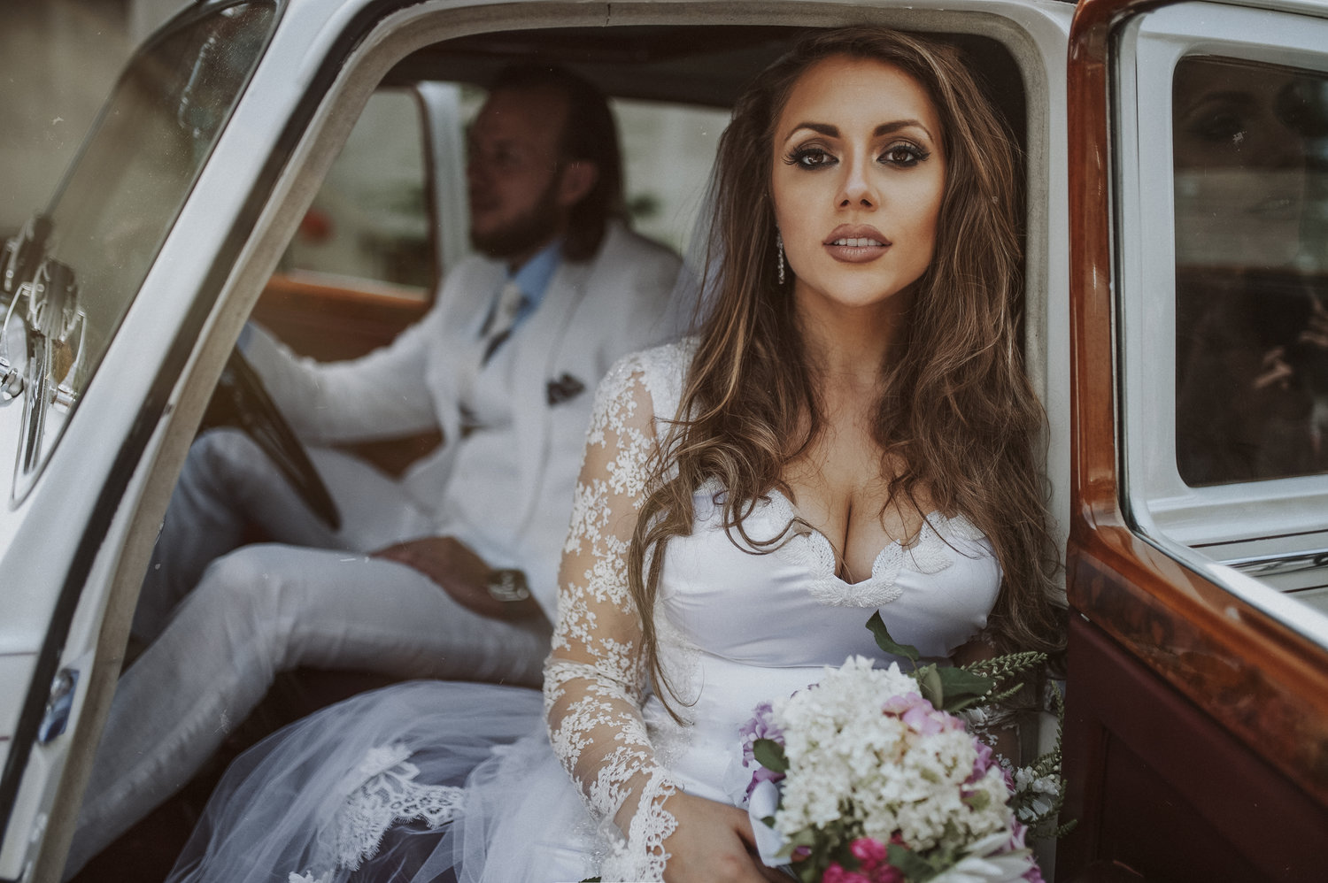 bride and groom arrive in vintage car wearing DIY wedding dress serbia Aleska and Mina Photography