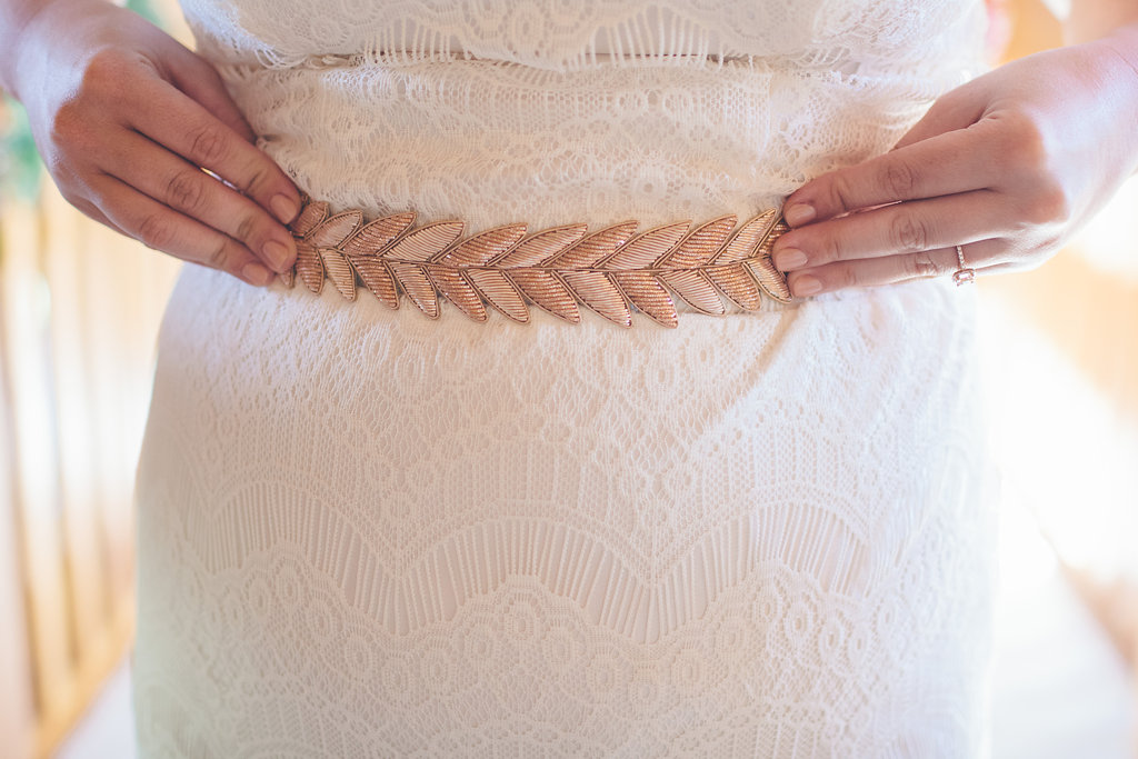 bride getting dressed in DIY wedding dress Colorado Cassandra Zetta Photography