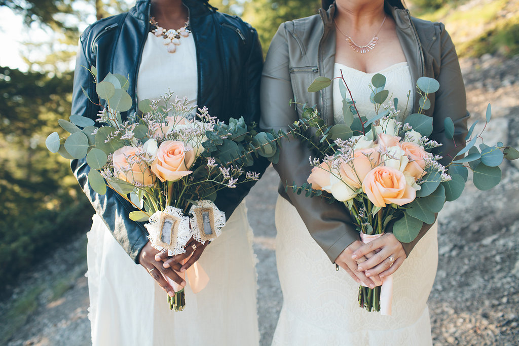brides in DIY wedding dresses and leather jackets while holding DIY bouquets at Colorado wedding Cassandra Zetta Photography