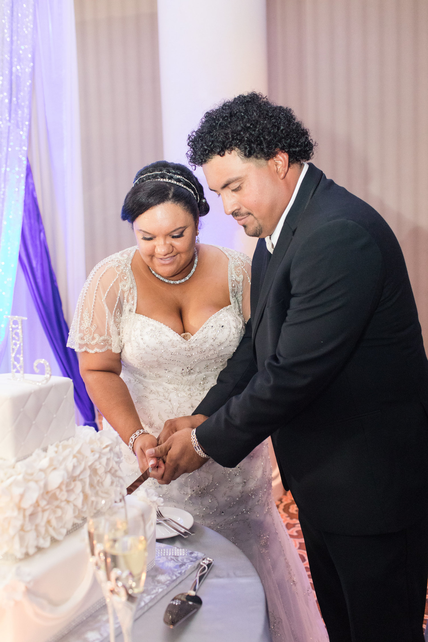 bride and groom cutting cake at vintage DIY wedding in Tysons Corner Photography by Marirosa