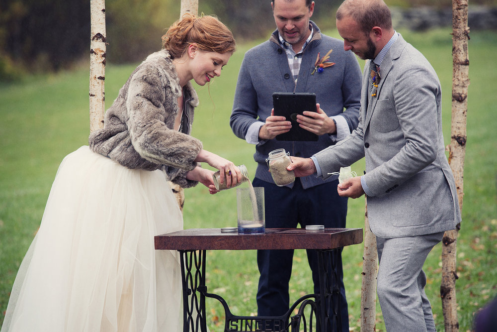 bride and groom sand unity ceremony with vintage sewing machine stand at DIY catskills wedding Ella Sophie Photo