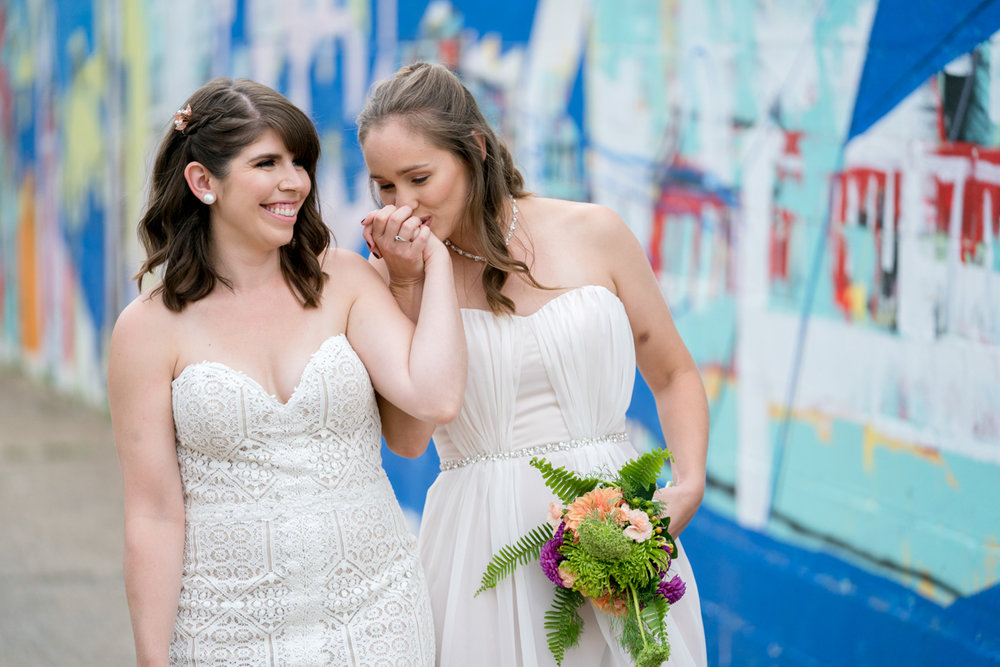 Maggie and Whitney hold hands before their DIY brewery wedding in DC Love Life Images
