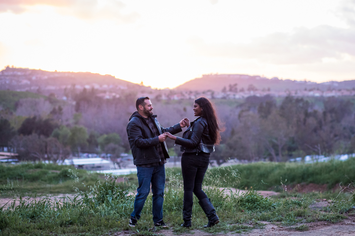 irvine regional park engagement session crystal lilly photography couple dancing with mountains in distance