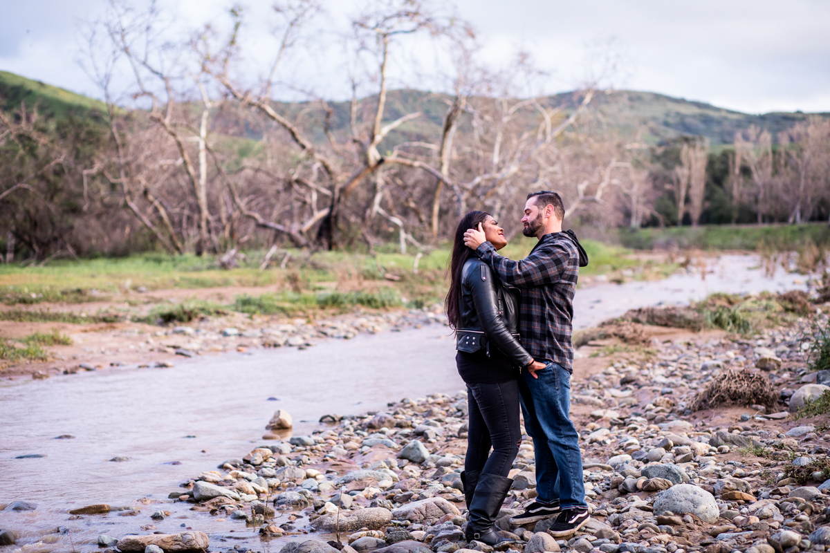 irvine regional park engagement session crystal lilly photography embrace next to rocky stream