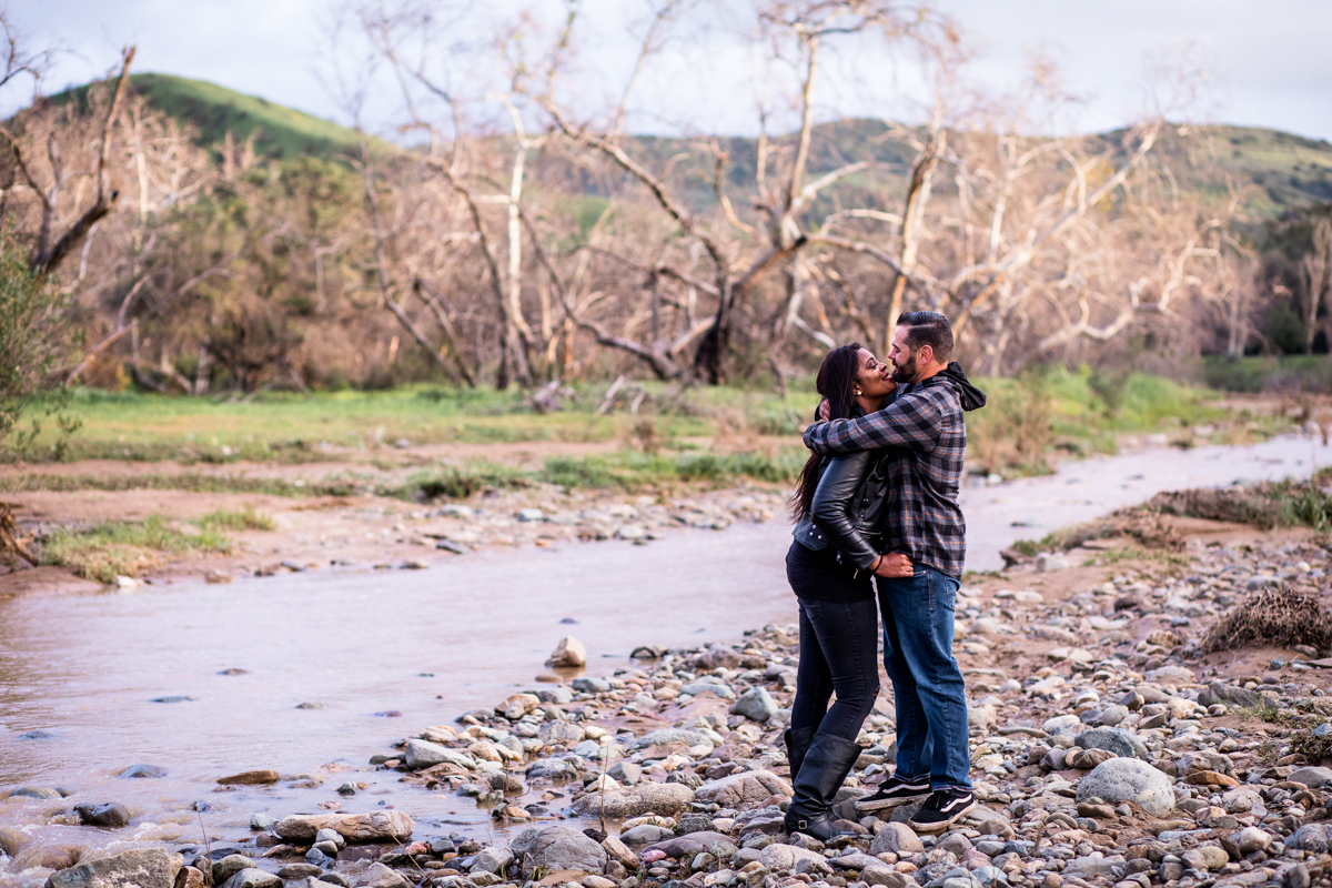 irvine regional park engagement session crystal lilly photography embrace candid by stream