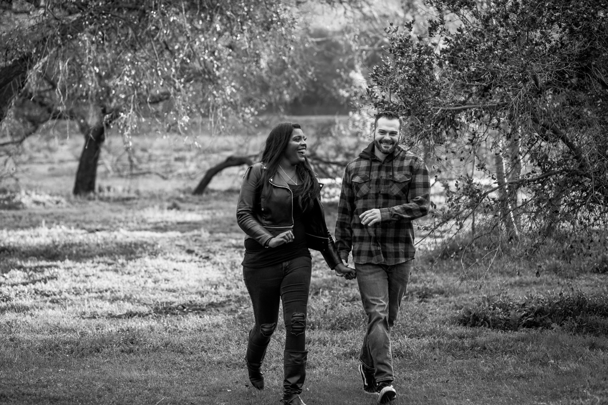 irvine regional park engagement session crystal lilly photography danielle and david walking and holding hands