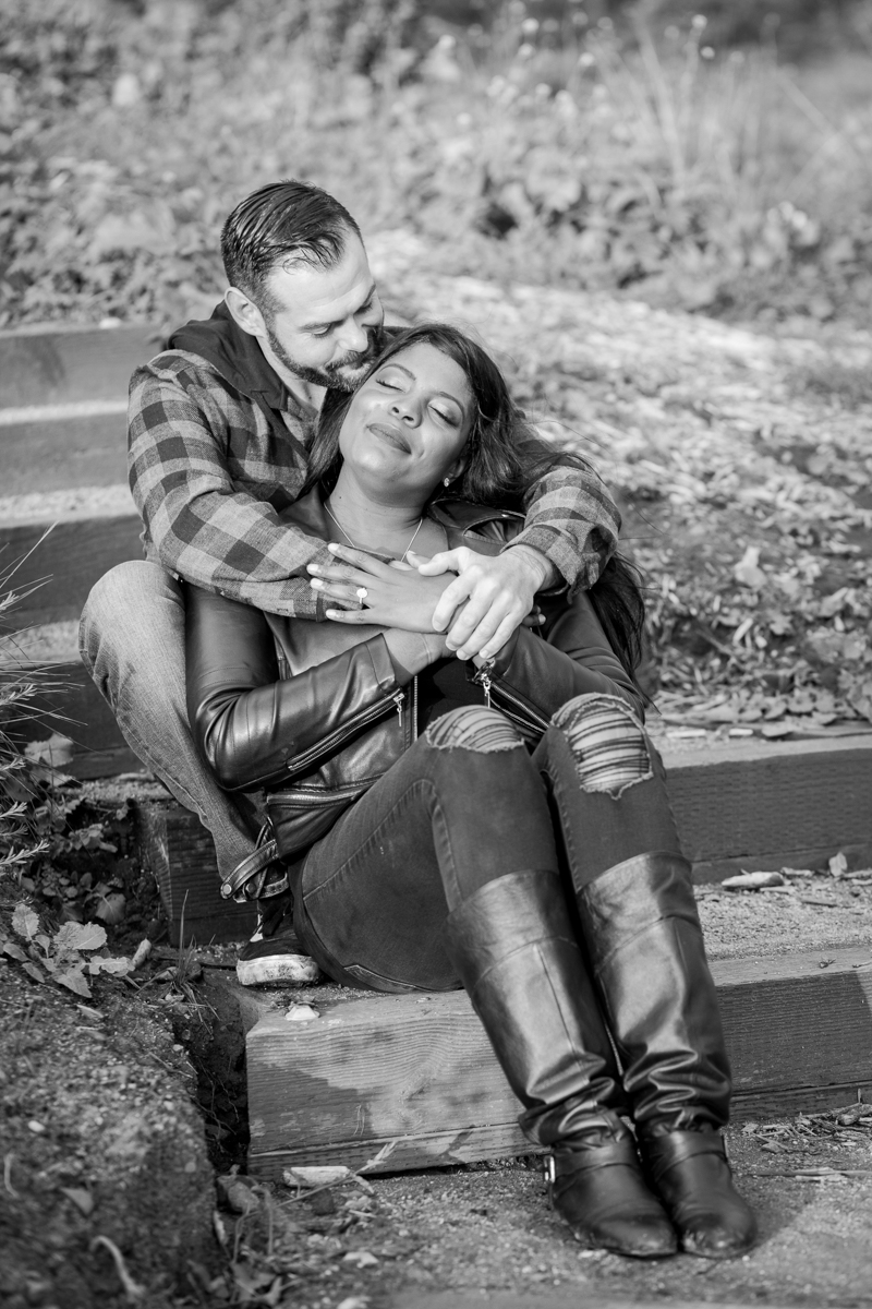 irvine regional park engagement session crystal lilly photography couple sitting on wood and dirt steps