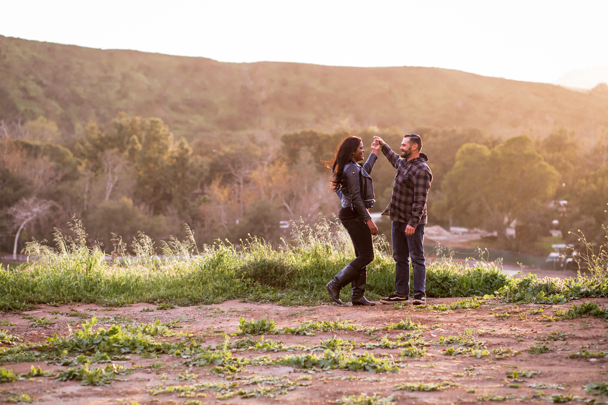 irvine regional park engagement session crystal lilly photography danielle and david holding hands on park hill
