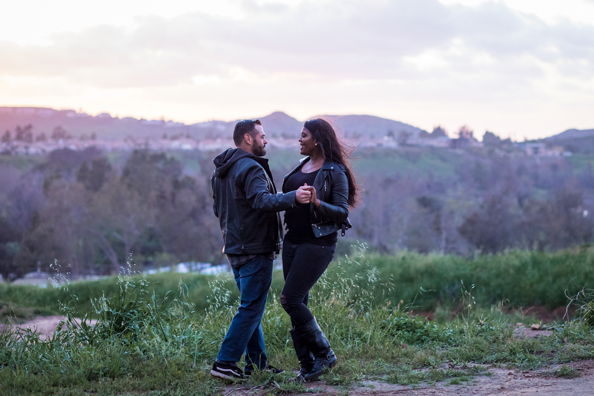 irvine regional park engagement session crystal lilly photography couple holding hands with mountains in distance