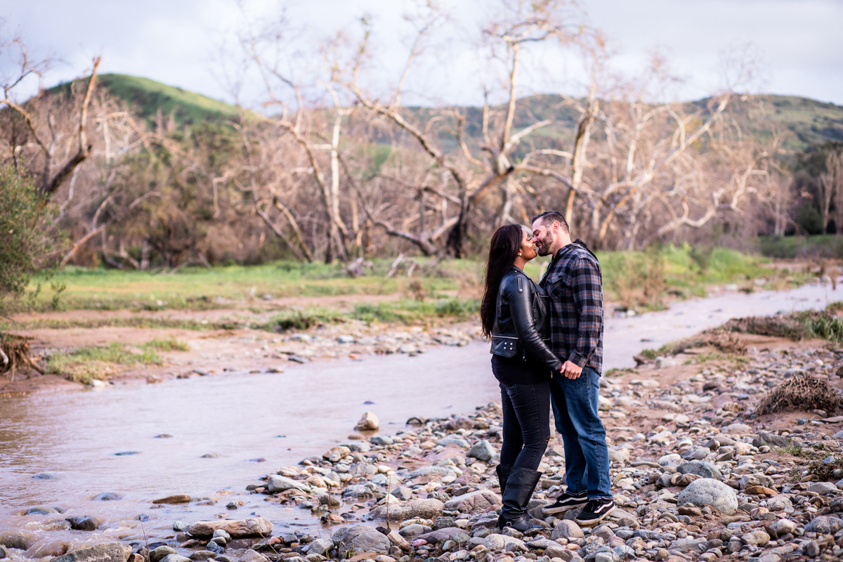 irvine regional park engagement session crystal lilly photography kiss by stream