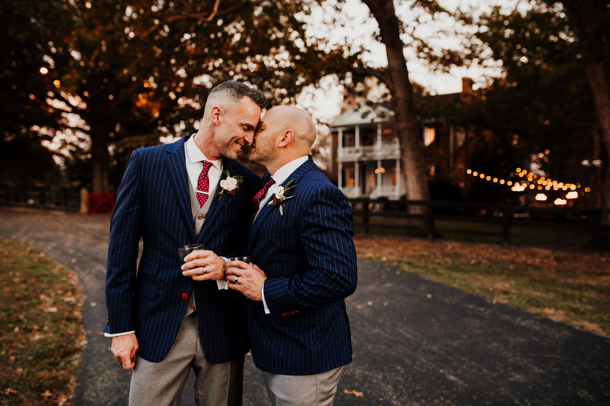 LGBTQ Louisville Kentucky Wedding at Hermitage Farm Crystal Ludwick Photo kiss on cheek
