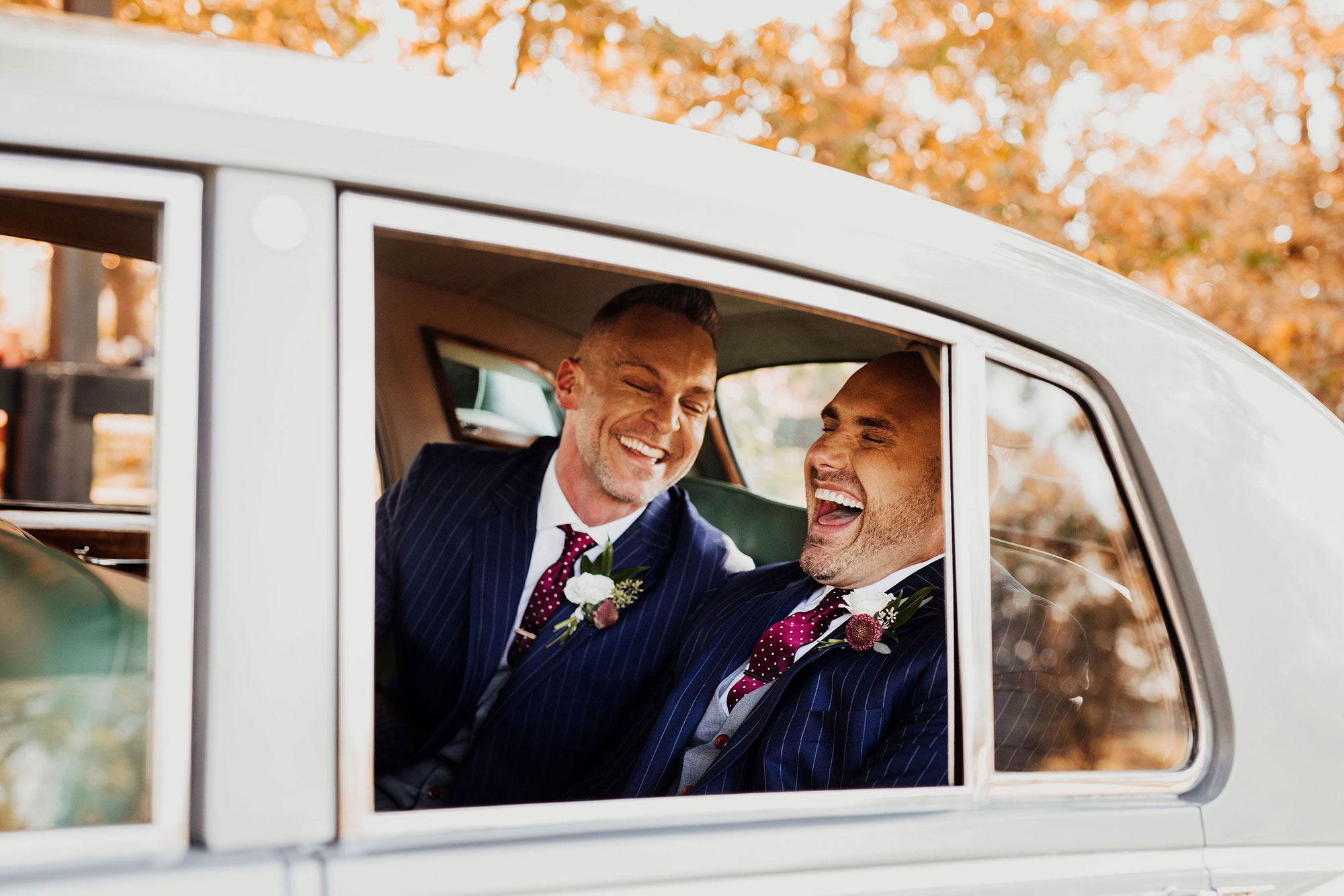 LGBTQ Louisville Kentucky Wedding at Hermitage Farm Crystal Ludwick Photo couple laughing in car