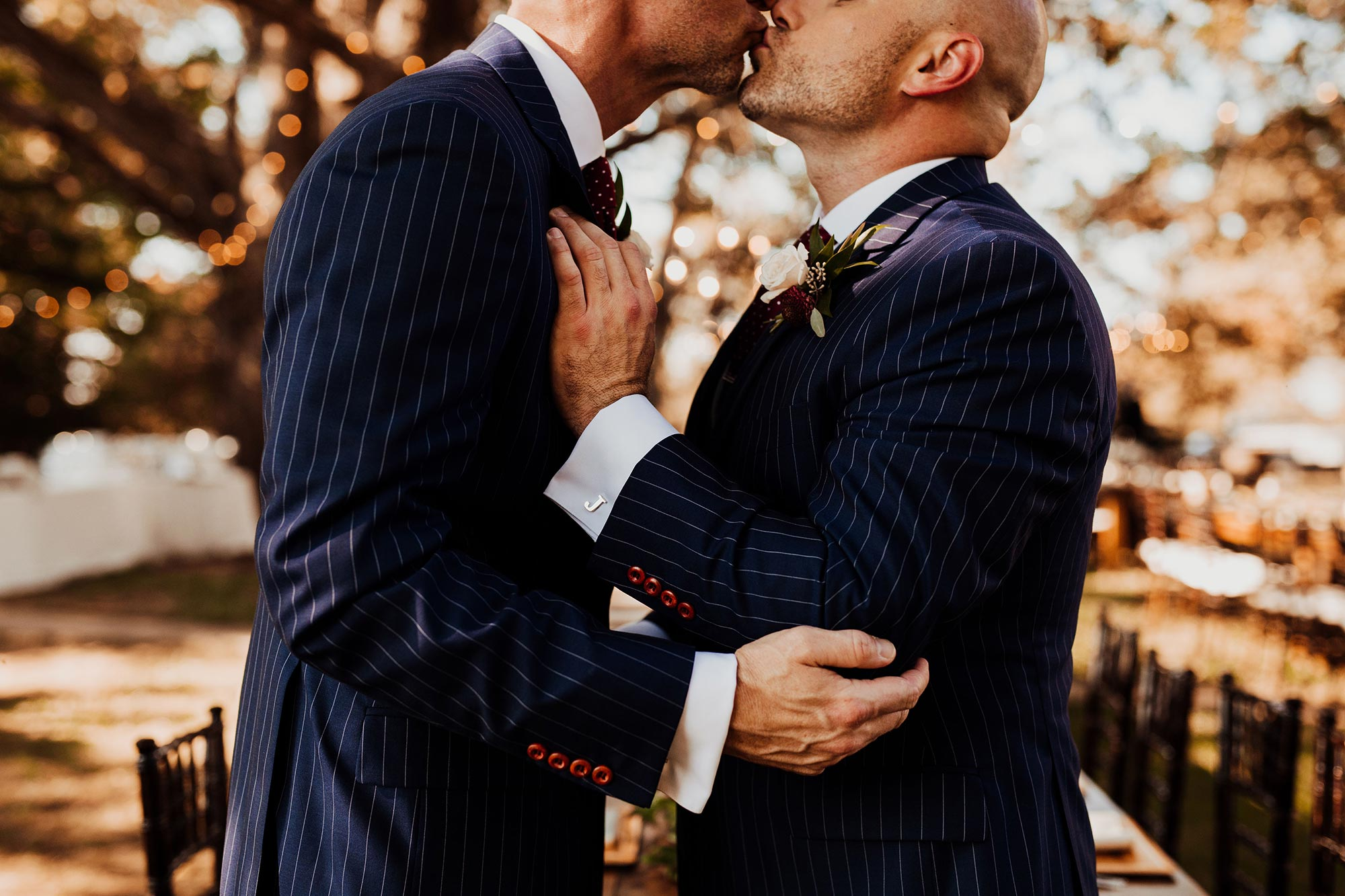 LGBTQ Louisville Kentucky Wedding at Hermitage Farm Crystal Ludwick Photo kiss outside