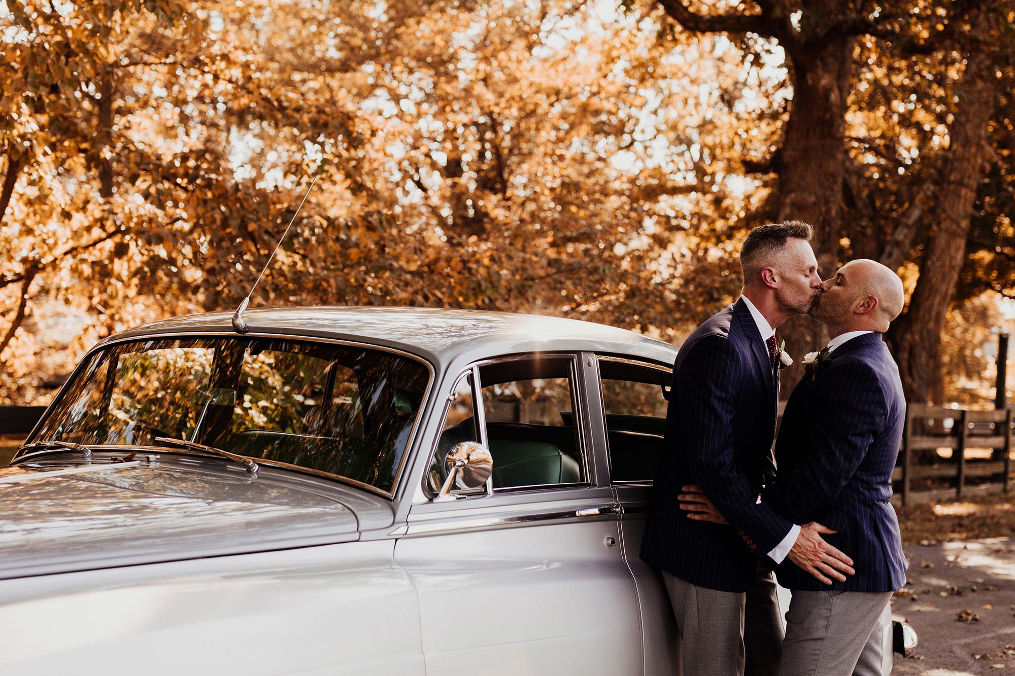 LGBTQ Louisville Kentucky Wedding at Hermitage Farm Crystal Ludwick Photo kiss by vintage car