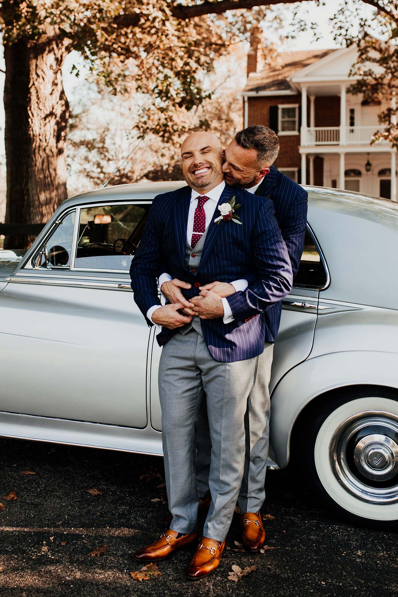 LGBTQ Louisville Kentucky Wedding at Hermitage Farm Crystal Ludwick Photo embrace by vintage car