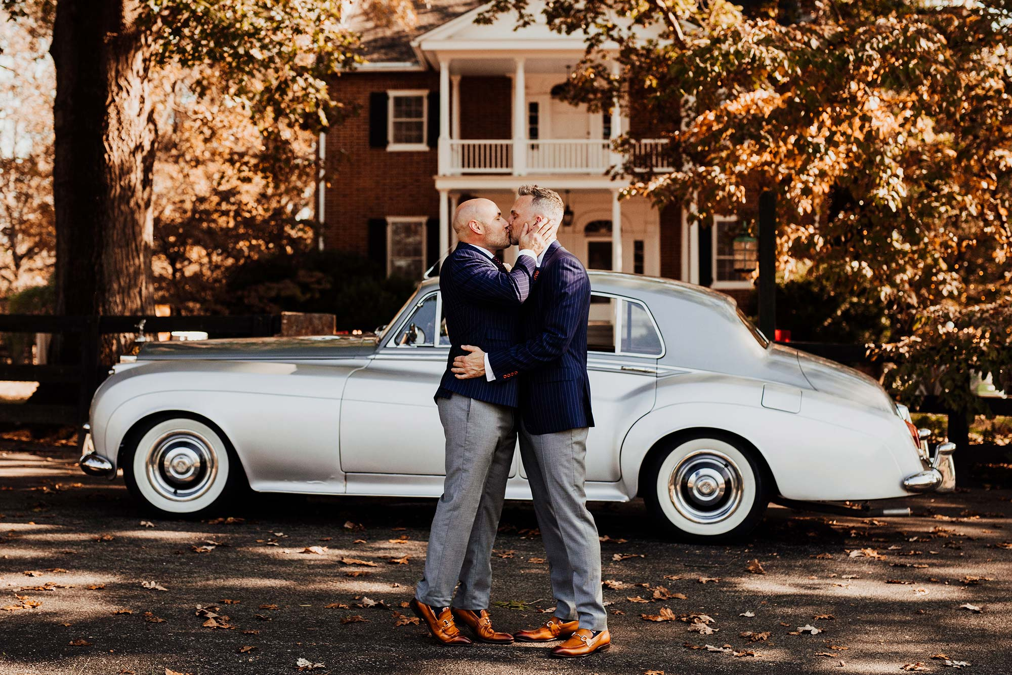 LGBTQ Louisville Kentucky Wedding at Hermitage Farm Crystal Ludwick Photo kiss in front of house and car