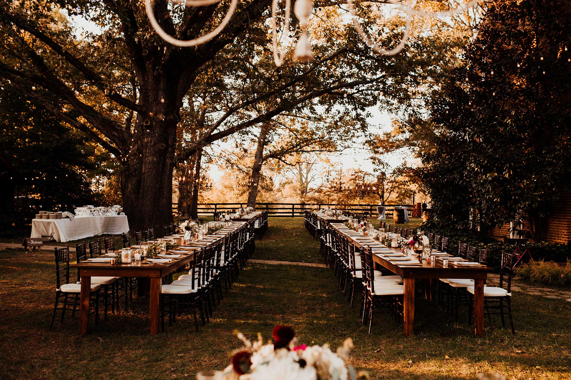 LGBTQ Louisville Kentucky Wedding at Hermitage Farm Crystal Ludwick Photo long reception tables outdoors