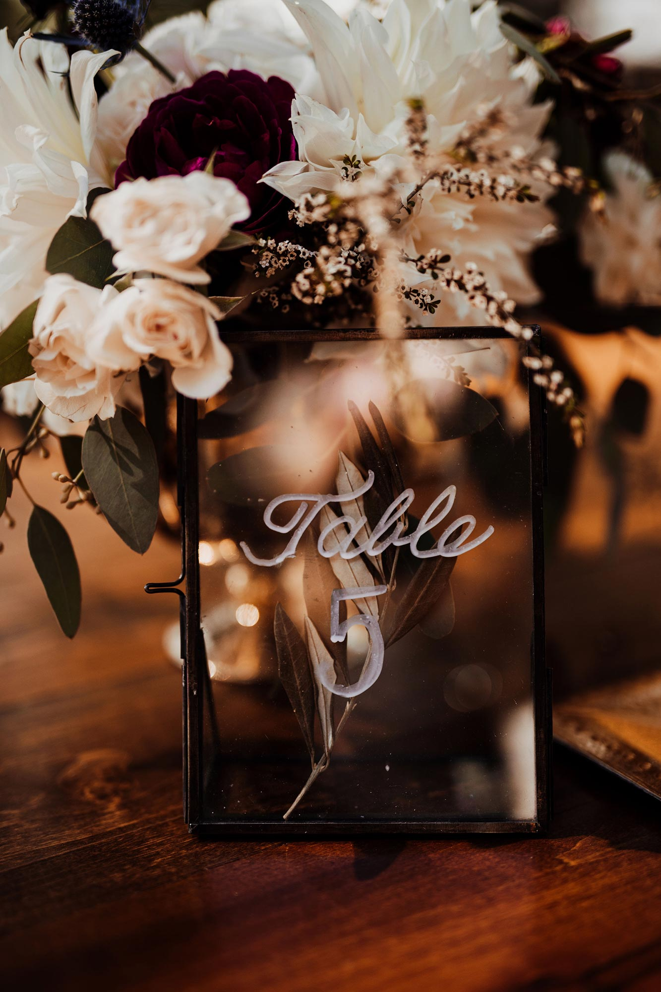 LGBTQ Louisville Kentucky Wedding at Hermitage Farm Crystal Ludwick Photo table marker with flowers
