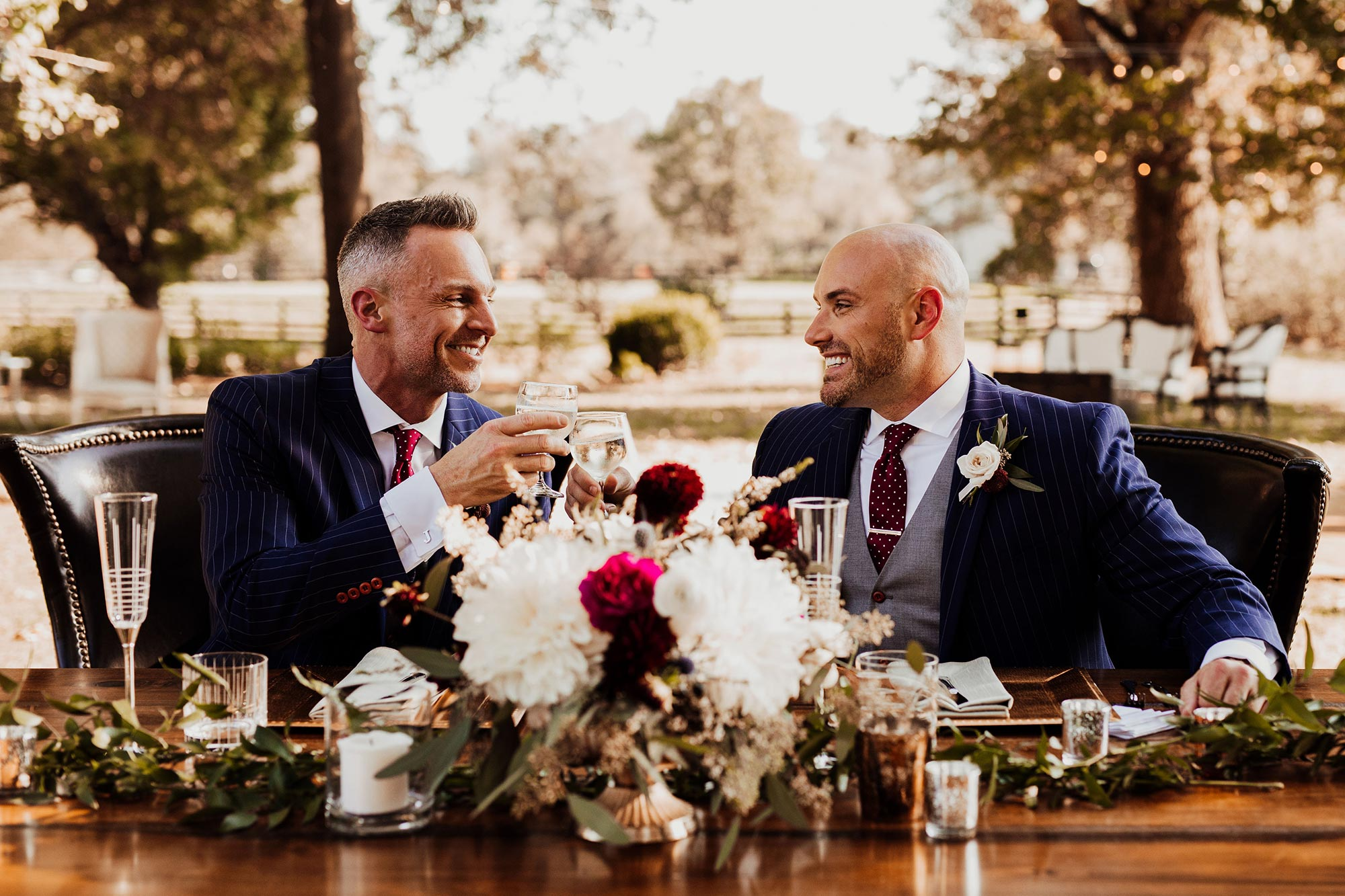 LGBTQ Louisville Kentucky Wedding at Hermitage Farm Crystal Ludwick Photo couple having drink at main table