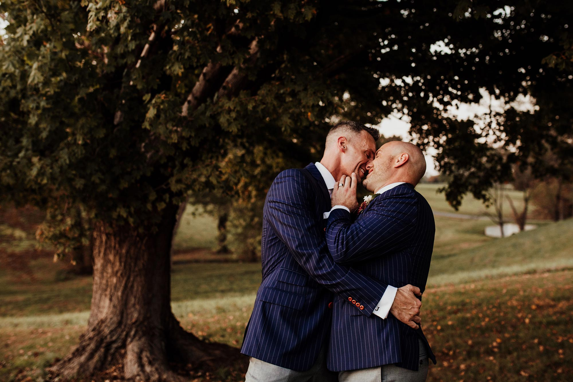 LGBTQ Louisville Kentucky Wedding at Hermitage Farm Crystal Ludwick Photo kiss in yard