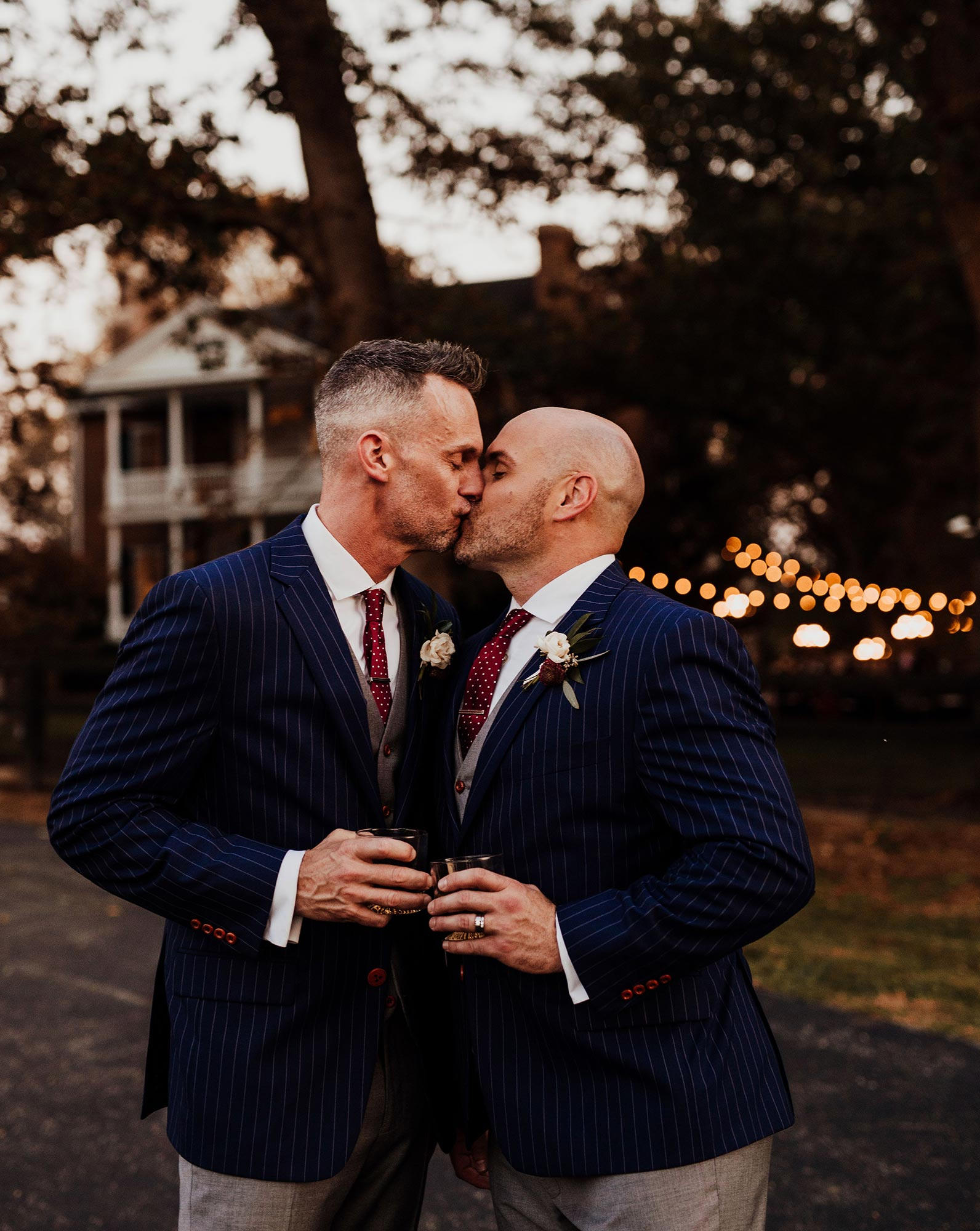LGBTQ Louisville Kentucky Wedding at Hermitage Farm Crystal Ludwick Photo kiss outside house