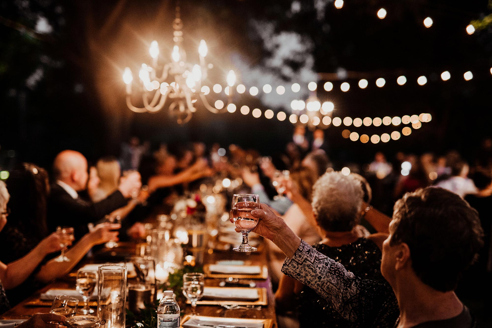 LGBTQ Louisville Kentucky Wedding at Hermitage Farm Crystal Ludwick Photo guests raising glasses for toast