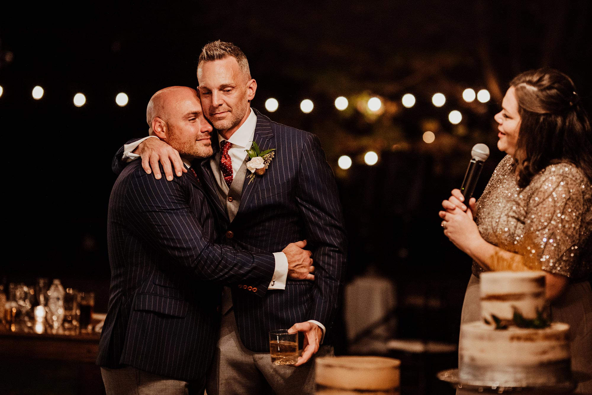 LGBTQ Louisville Kentucky Wedding at Hermitage Farm Crystal Ludwick Photo couple hugs while friend gives speech