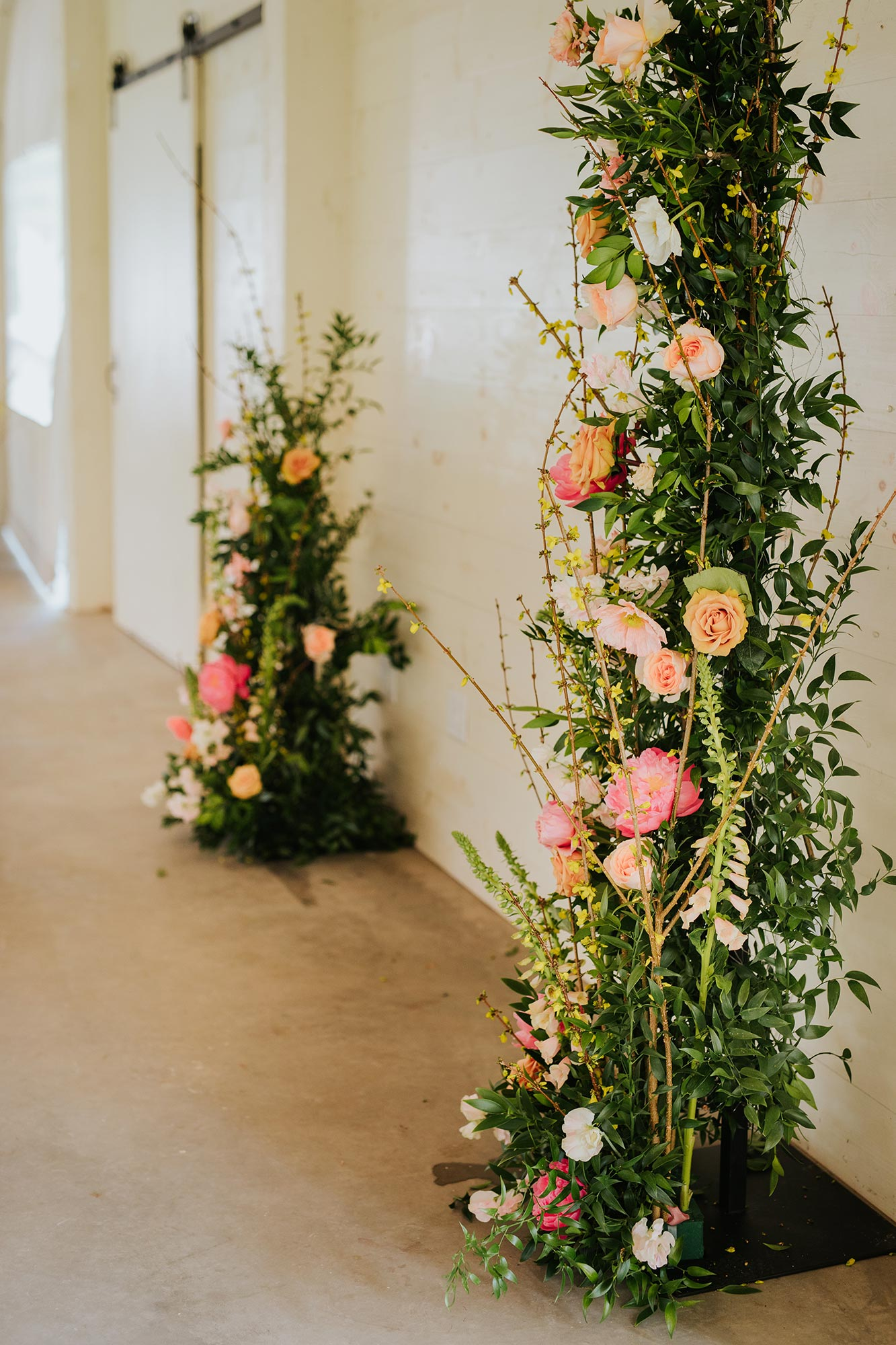 Lush wedding inspiration at Seven Springs VA with freestanding floral ceremony pillars Carly Romeo & Co.