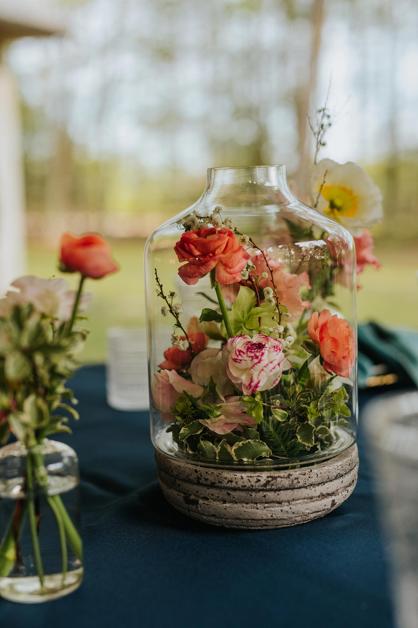 Lush wedding inspiration at Seven Springs VA with pink and teal velvet table setting with stone terrarium Carly Romeo & Co.