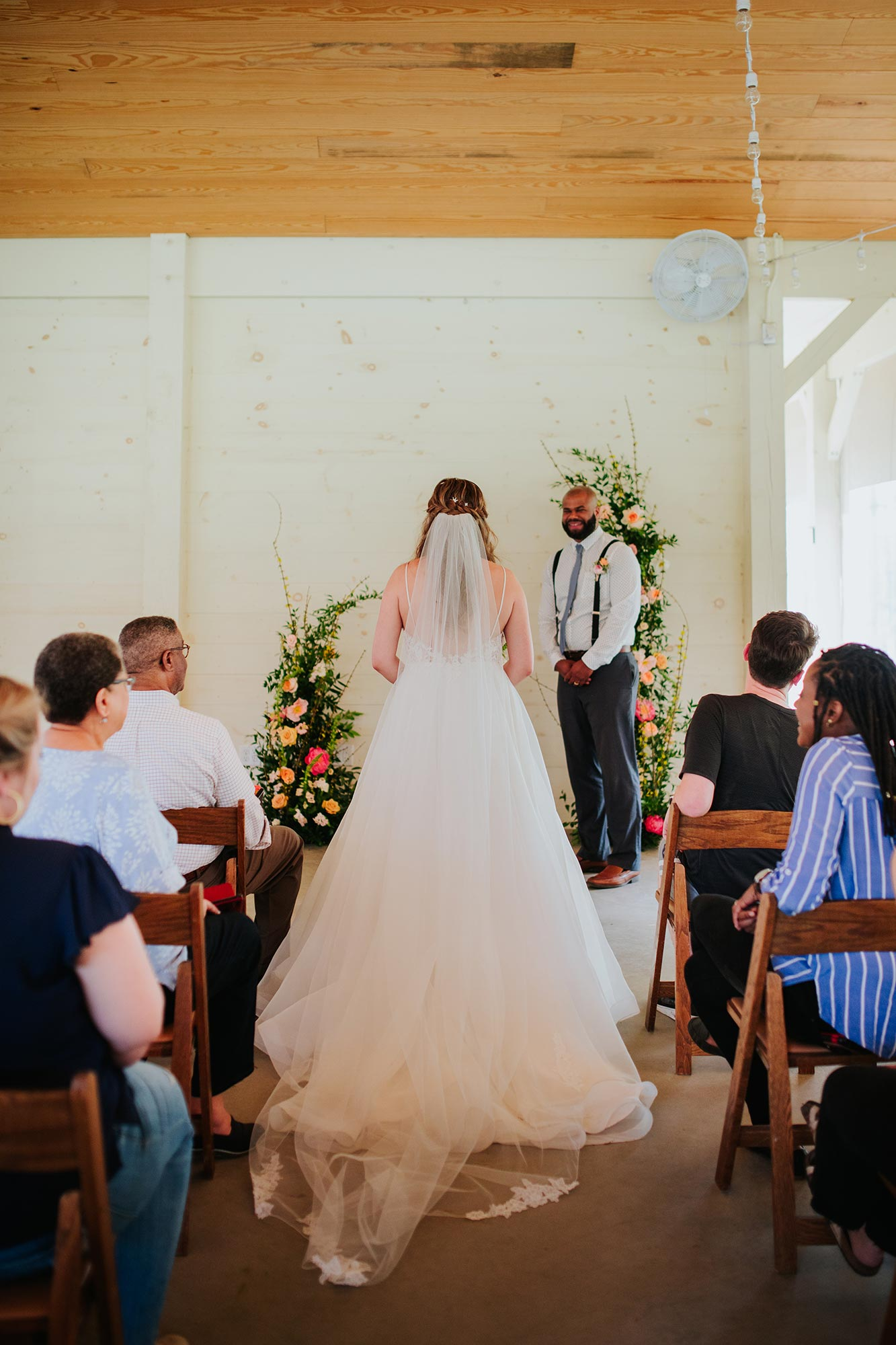 Lush wedding inspiration at Seven Springs VA with bride walking into ceremony Carly Romeo & Co.