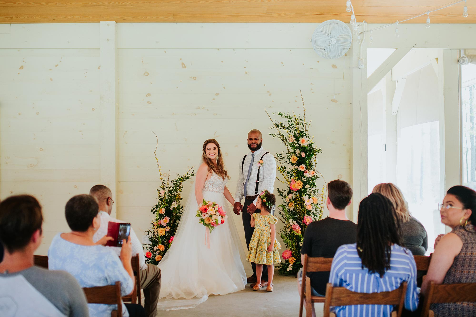 Lush wedding inspiration at Seven Springs VA with bride and groom and daughter during ceremony Carly Romeo & Co.