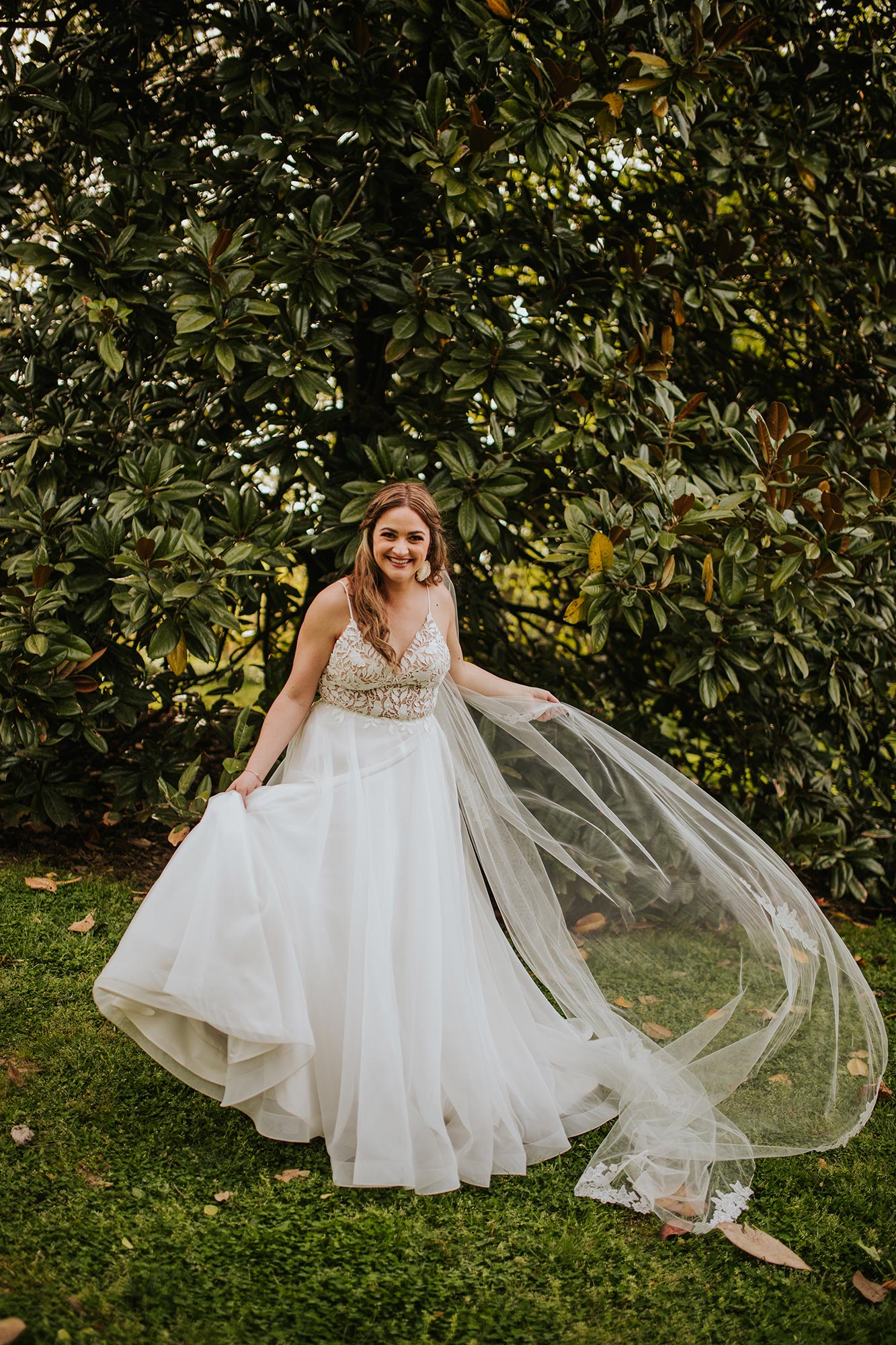 Lush wedding inspiration at Seven Springs VA with bride twirling in dress in grass Carly Romeo & Co.