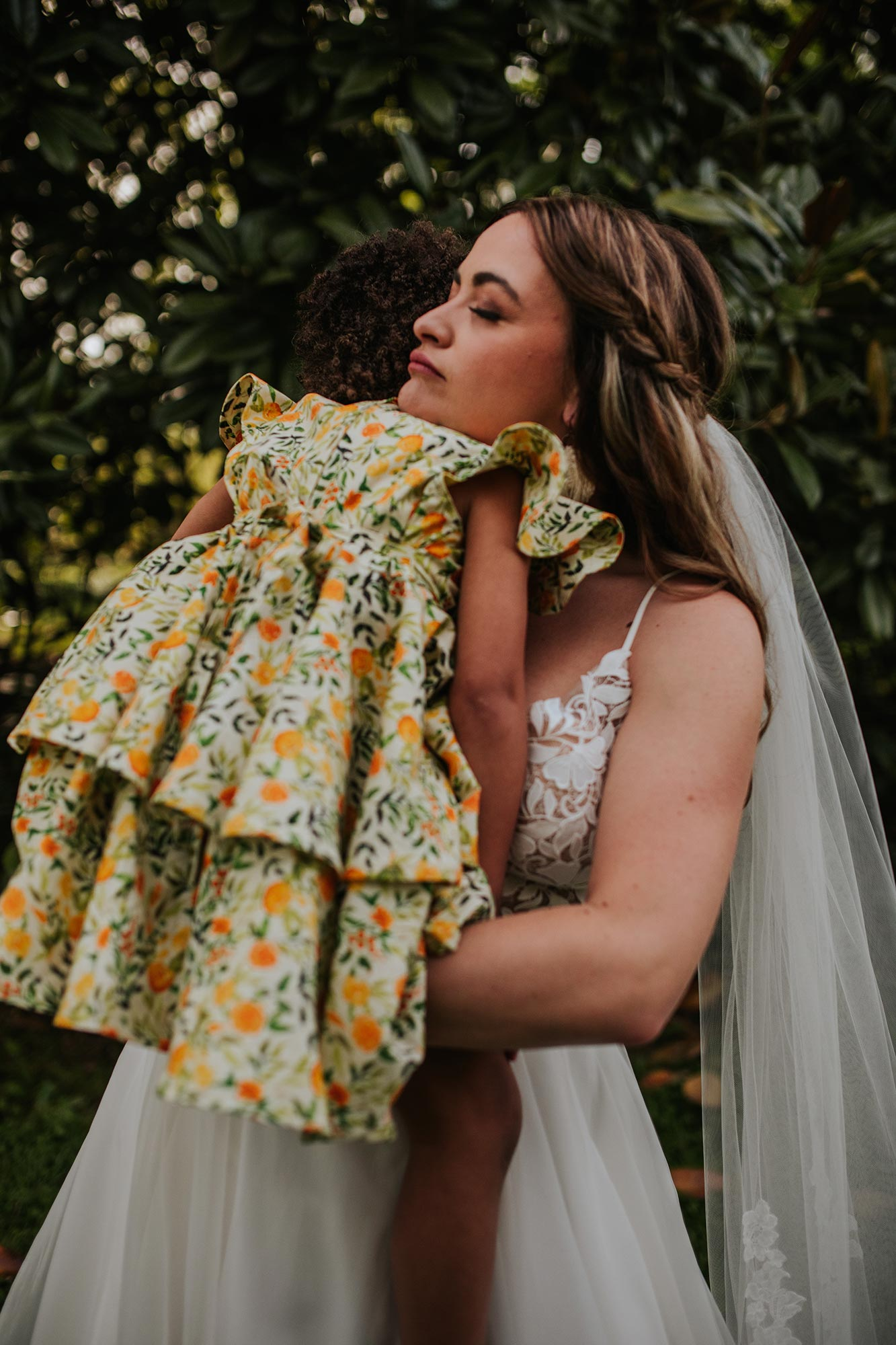 Lush wedding inspiration at Seven Springs VA with bride carrying daughter Carly Romeo & Co.
