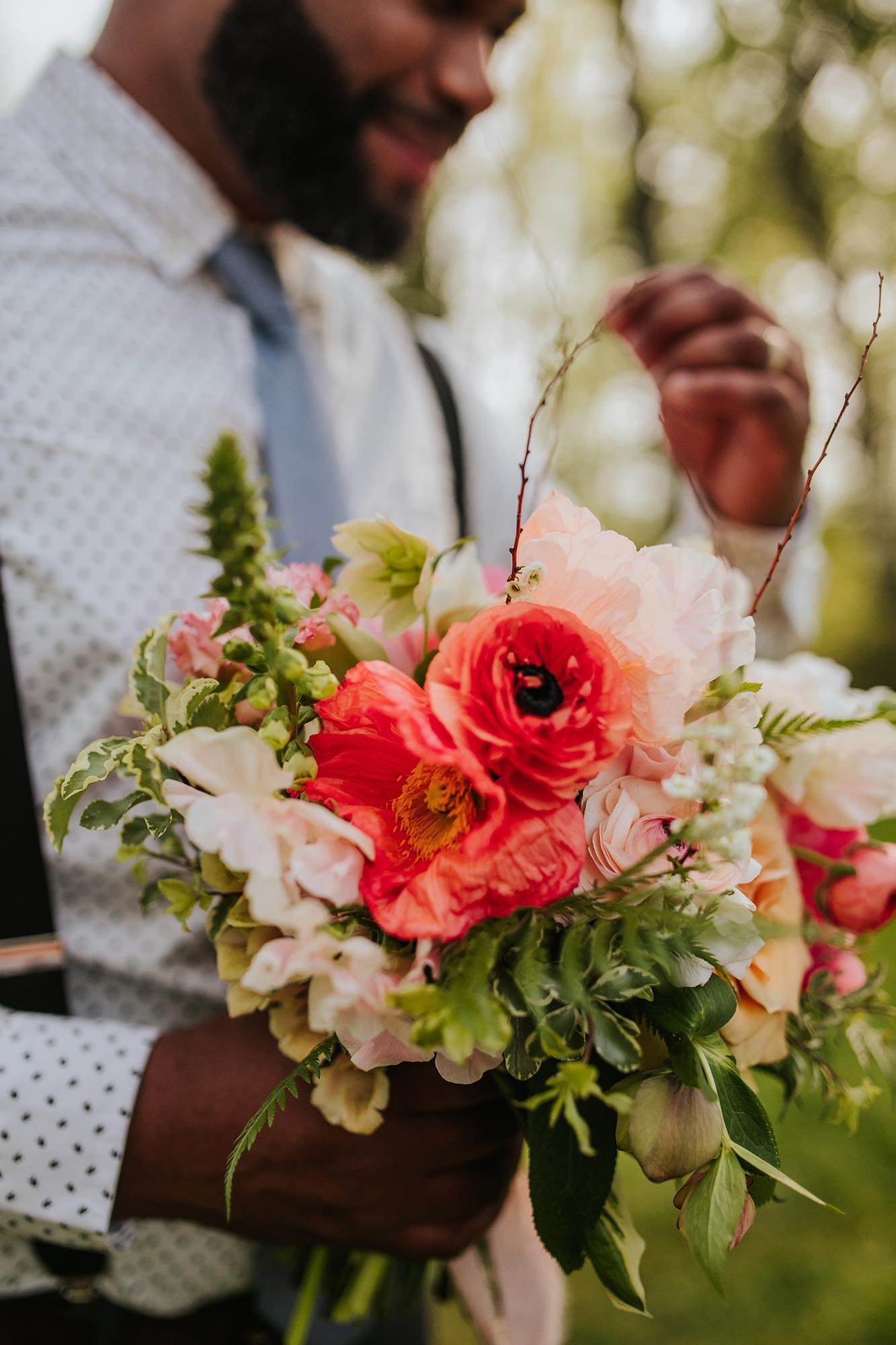 Lush wedding inspiration at Seven Springs VA with groom holding bouquet Carly Romeo & Co.