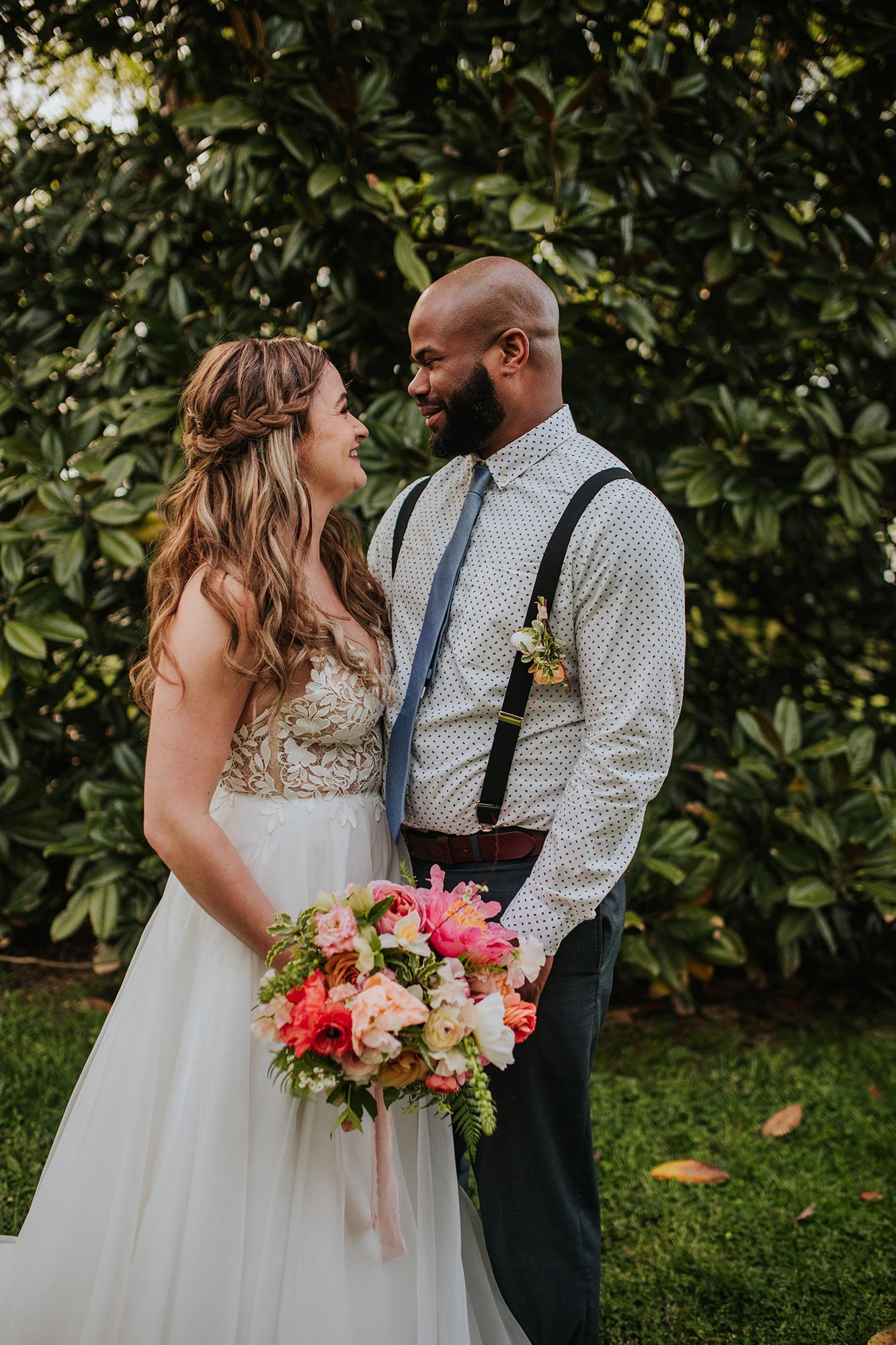Lush wedding inspiration at Seven Springs VA with bride and groom embraced in garden Carly Romeo & Co.