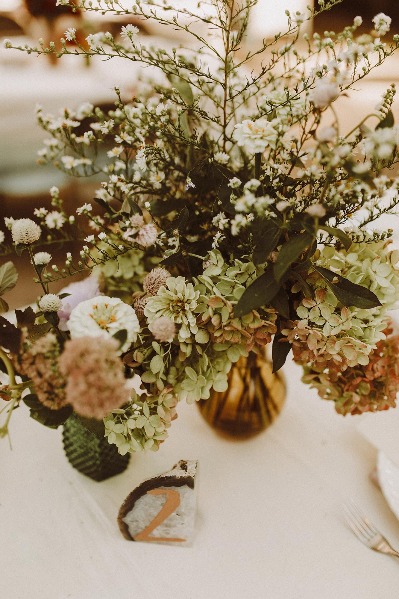 DIY summer camp wedding spring green wisconsin heidi uhlman photography geode and floral centerpieces