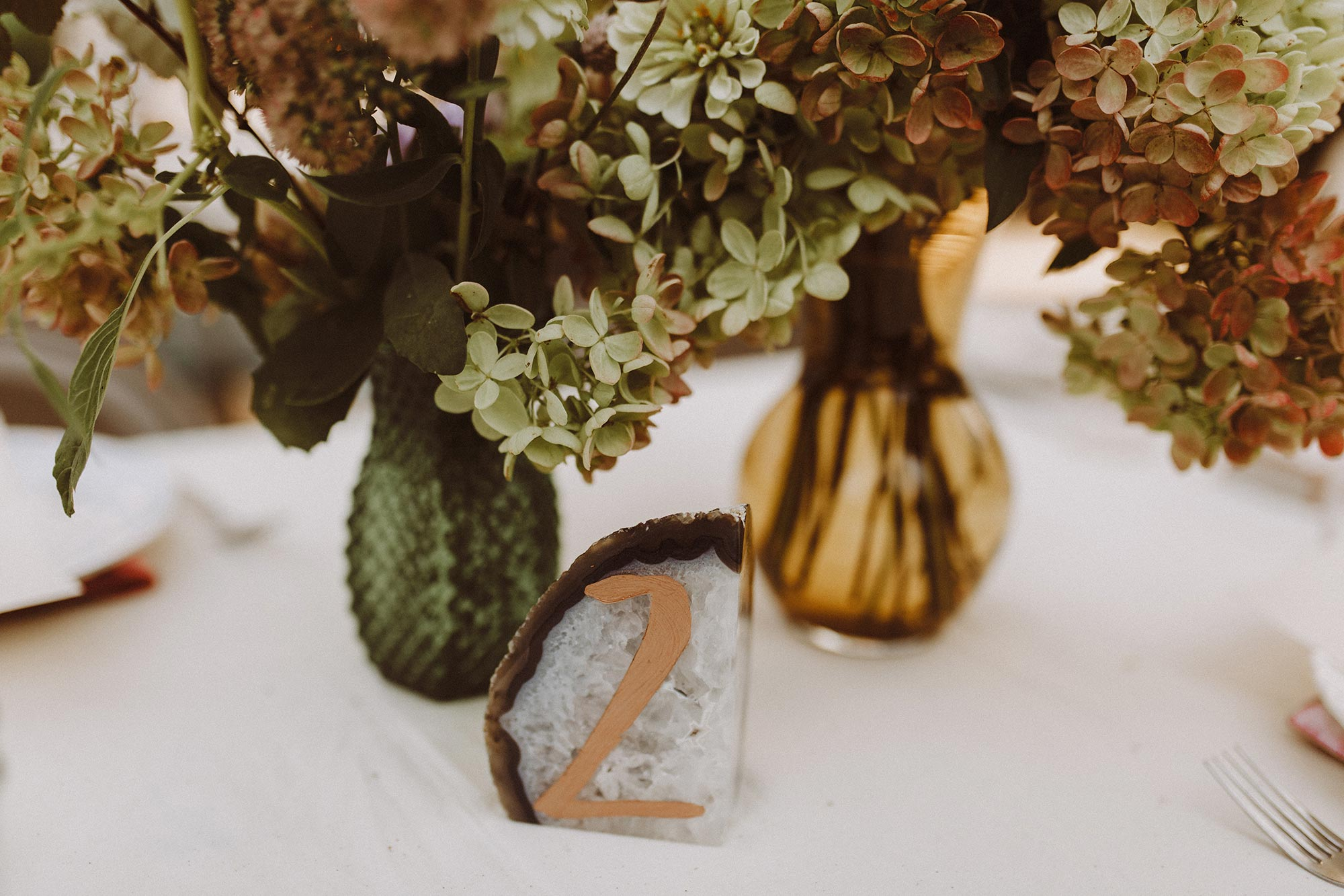 DIY summer camp wedding spring green wisconsin heidi uhlman photography geode with table number