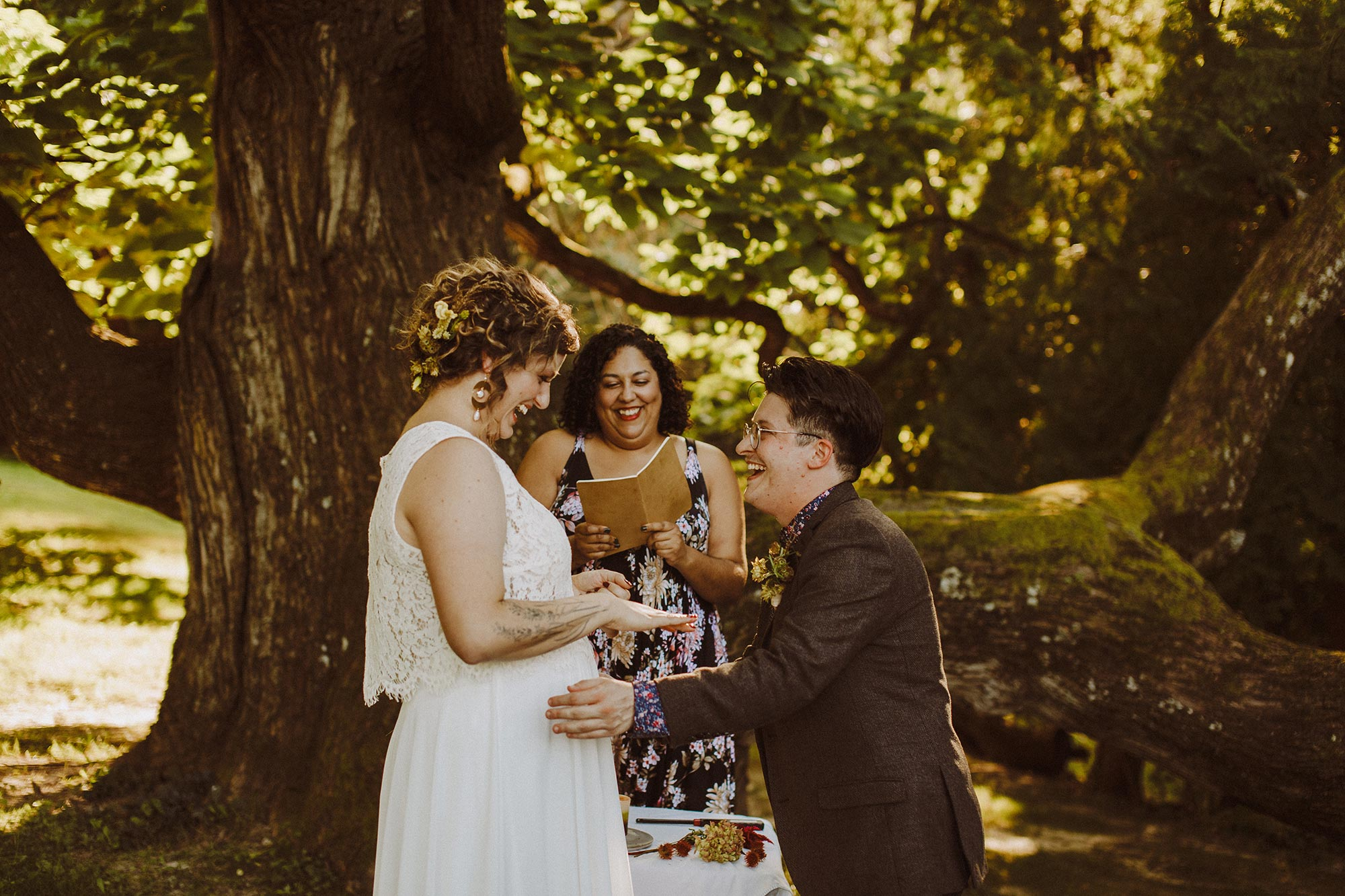 DIY summer camp wedding spring green wisconsin heidi uhlman photography exchanging rings