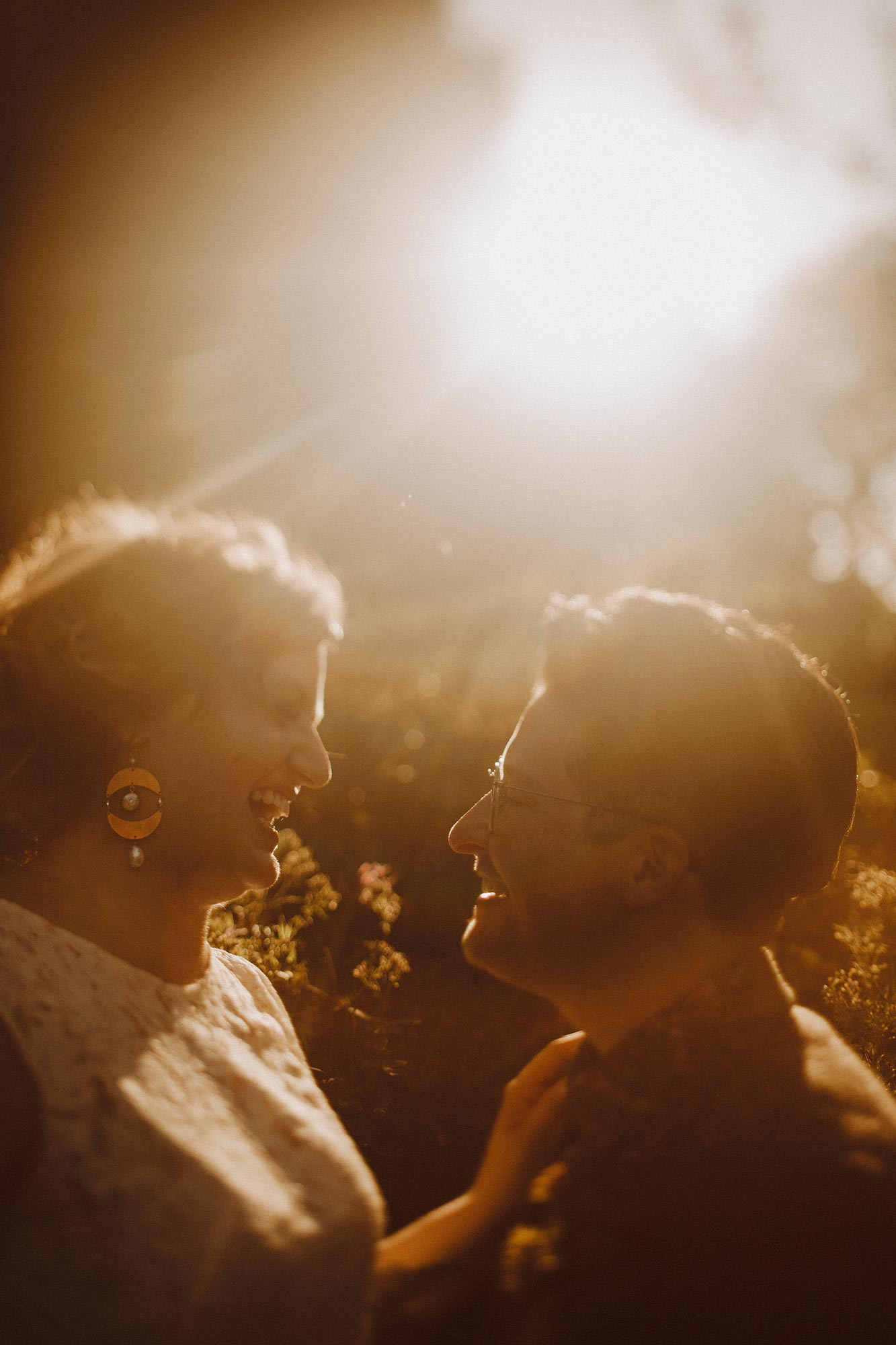 DIY summer camp wedding spring green wisconsin heidi uhlman photography couple laughing in sunlight