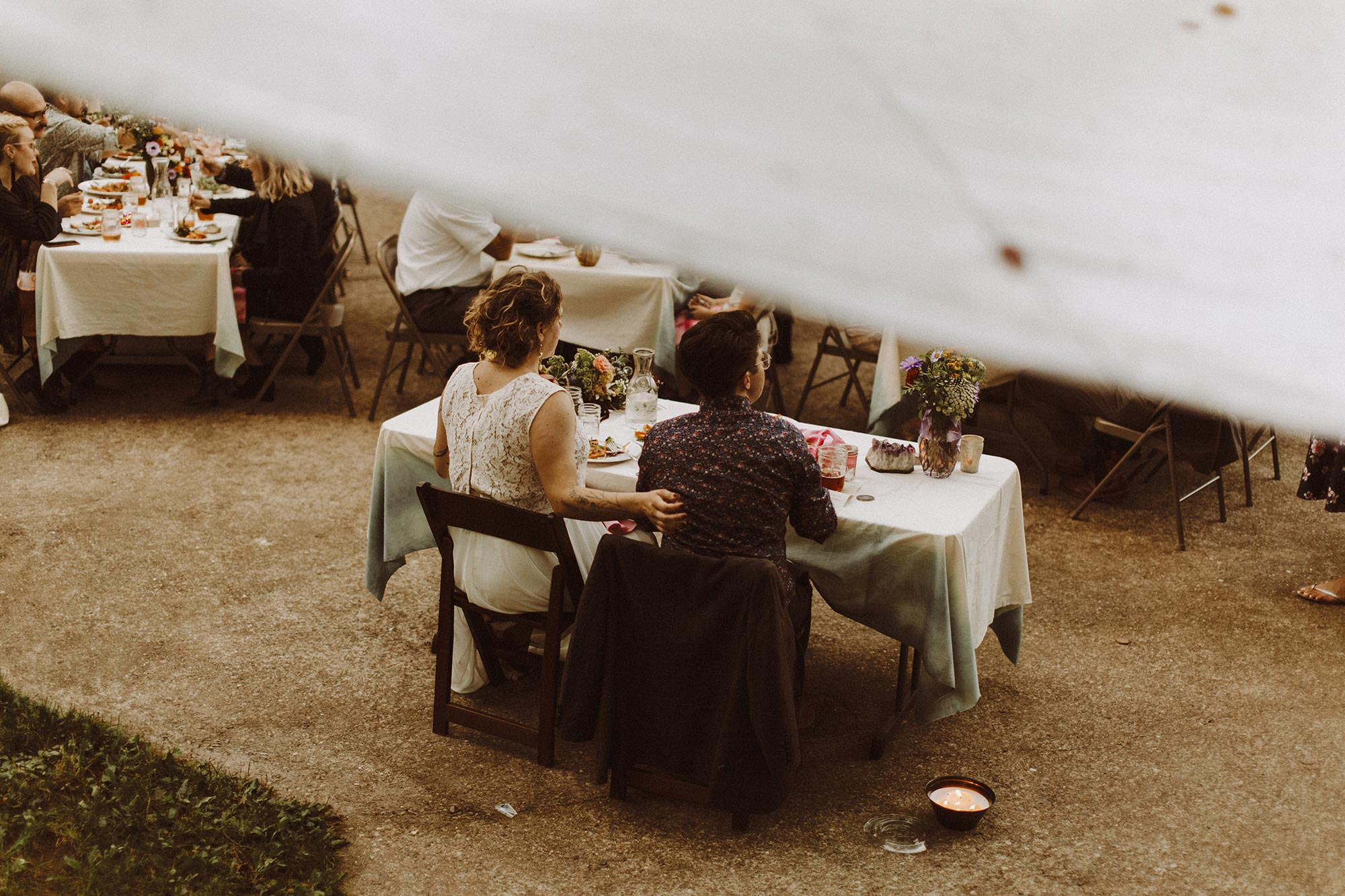 DIY summer camp wedding spring green wisconsin heidi uhlman photography married couple at main table