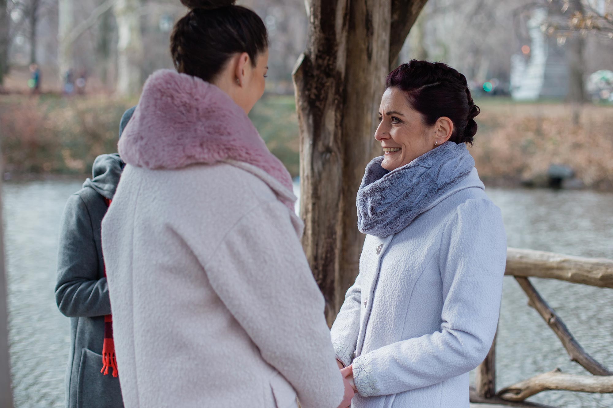 queer irish central park winter elopement kate alison photography kathryn and mary in coats ceremony