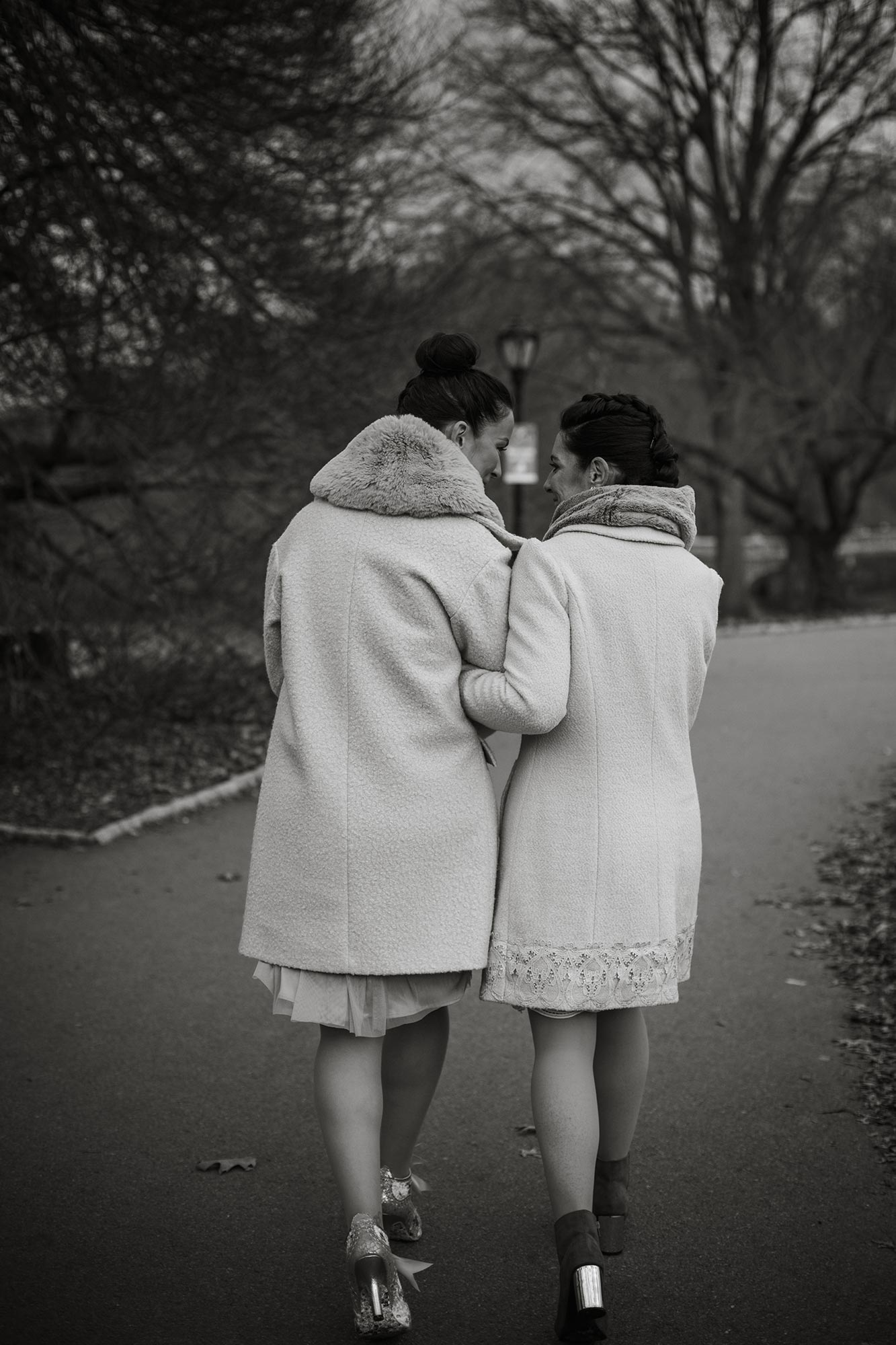 queer irish central park winter elopement kate alison photography kathryn and mary walking arm in arm down park path